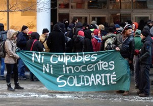 Supporters of Fallon Rouiller Poisson demonstrate in front of the Mexican consulate Thursday, January 9, 2014 in Montreal. Mexican authorities detained Canadians Amelie Pelletier and Fallon Rouiller Poisson earlier this week following a Molotov cocktail attack Monday against a government office in the capital. THE CANADIAN PRESS/Andy Blatchford