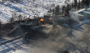Derailed train cars continue to burn in Plaster Rock, N.B., Jan.8, 2014. THE CANADIAN PRESS/Tom Bateman