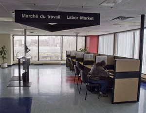A man looks through jobs at a Resource Canada offices in Montreal April 9, 2009. THE CANADIAN PRESS/Ryan Remiorz