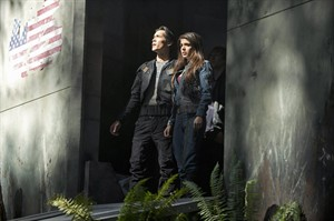 """This publicity image released by The CW shows Bob Morley as Bellamy, left, and Marie Avgeropoulos as Octavia in the pilot episode of the new series """"The 100,"""" premiering this fall on The CW. THE CANADIAN PRESS/AP-The CW, Cate Cameron"""