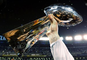The Lombardi Trophy is raised during celebrations after the NFL Super Bowl XLVIII football game Sunday, Feb. 2, 2014, in East Rutherford, N.J. The Seahawks won 43-8. (AP Photo/Paul Sancya)