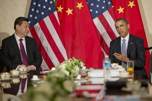 US President Barack Obama during a bilateral meeting with Chinese President Xi Jinping at the US Ambassador's Residence in Amsterdam, Netherlands, Monday, March 24, 2014. Obama is in the Netherlands for the Nuclear Security Summit in The Hague, which will form the backdrop for an emergency meeting of Group of Seven leaders on Russia's annexation of Crimea. (AP Photo/Pablo Martinez Monsivais)
