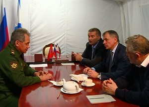 In this image provided by the Associated Press Television News Russian Defense Minister Sergei Shoigu, left, meets with, from left : Crimean Premier Sergei Aksyonov, Speaker of Crimean legislature Vladimir Konstantinov, Sevastopol mayor Alexei Chalyi at a military base in Sevastopol, Crimea on Monday, March 24, 2014. Shoigu's visit comes as Ukraine's fledgling government on Monday ordered Ukrainian troops to withdraw from Crimea, ending days of wavering as Russian troops consolidate control over the peninsula. (AP photo/APTN)