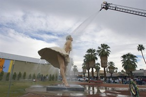 """FILE - This Jan. 23, 2013 file photo shows the """"Forever Marilyn"""" sculpture getting a shower from the Palm Springs Fire Department in Palm Springs, Calif. Palm Springs is singing """"Goodbye, Norma Jean."""" The city is throwing a send-off party Thursday March 27, 2014, for this massive statue of Marilyn Monroe that has become beloved by both tourists and locals in the two years it was on loan from The Sculpture Foundation.(AP Photo/The Desert Sun, Jay Calderon,File) RIVERSIDE PRESS-ENTERPRISE OUT; NO SALES; NO FOREIGN"""