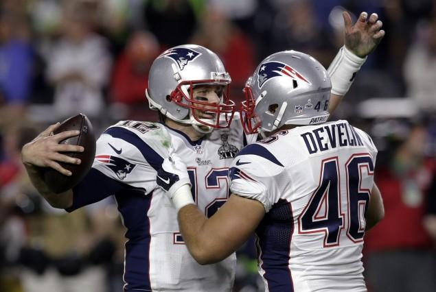 New England Patriots quarterback Tom Brady (12) celebrates with New England Patriots fullback James Develin (46) after NFL Super Bowl XLIX football game against the Seattle Seahawks Sunday, Feb. 1, 2015, in Glendale, Ariz. The Patriots won 28-24. (AP Photo/Patrick Semansky)