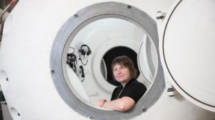 Sherri Ferguson sits in SFU's hyperbaric chamber, which will be used in clinical trials investigating the efficacy of Hyperbaric Oxygen Therapy in treating autism.