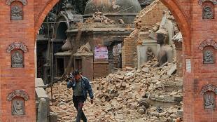 A Nepalese man cries as he walks through the earthquake debris in Bhaktapur (AP)