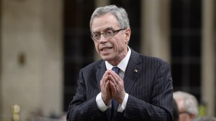 Finance Minister Joe Oliver rises during Question Period in the House of Commons on Parliament Hill in Ottawa, Thursday April 30, 2015. Oliver says the government's budget fulfills its promise to balance the books while cutting the tax burden for Canadians. THE CANADIAN PRESS/Adrian Wyld