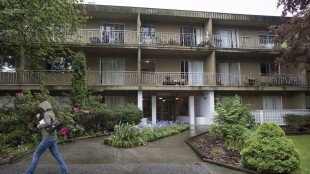 The outside of a Burnaby, B.C. apartment building is pictured Tuesday, May 5, 2015. A B.C. landlord has unleashed his inner pet detective with demands that residents who own about 30 dogs submit samples of their animal's excrement to pinpoint the 'poopetrator' fouling the stairwell. THE CANADIAN PRESS/Jonathan Hayward