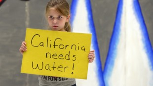 Neveah Craft, a third grader in Capistrano elementary school's after school program, holds a sign about the drought during a rehearsal in their talent show Monday, May 4, 2015 in Modesto, Calif. The kids at Capistrano participated in a drought awareness presentation, to learn about how the drought is affecting California. (Joan Barnett Lee/The Modesto Bee via AP) LOCAL TELEVISION OUT (KXTV10, KCRA3, KOVR13, FOX40, KMAX31, KQCA58, CENTRAL VALLEY TV); LOCAL PRINT OUT (TURLOCK JOURNAL, CERES COURIER, OAKDALE LEADER, MODESTO VIEW, PATTERSON IRRIGATOR, MANTECA BULLETIN, RIPON, RECROD, SONORA UNION DEMOCRAT, AMADOR LEDGER DISPATCH, ESCALON TIMES, CALAVERAS ENTERPRISE, RIVERBANKS NEWS) LOCAL INTERNET OUT (TURLOCK CITY NEWS.COM, MOTHER LODE.COM); MANDATORY CREDIT
