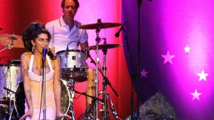 FILE -In this Jan. 8, 2011 file photo, British artist Amy Winehouse, left, performs during her show in Florianopolis, Brazil. At the 68th international Cannes film festival the Amy Winehouse director Asif Kapadia says we all share blame for her death.(AP Photo/Nabor Goulart, File)