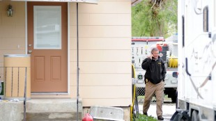 Billings Police Department Lt. Jeremy House walks past the house where a 15-year-old boy was shot and killed earlier in the morning, Sunday, May 17, 2015. A Montana boy startled at being awakened in the middle of the night fired a shot through his bedroom window and killed the 15-year-old friend who had been knocking and throwing pebbles at his window, police said Monday. (Hannah Potes/The Billings Gazette via AP)