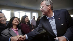 Former Florida Gov. Jeb Bush, right, reaches to shake hands at a house party in Bedford, N.H., on May 20, 2015. Presumed U.S. Republican presidential candidate Jeb Bush issued a strong call for improved U.S.-Canada relations Wednesday during a speech in New Hampshire. THE CANADIAN PRESS/AP, Jim Cole