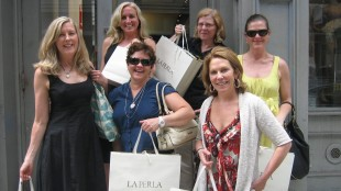 In this May 2011 photo provided by Becky Aikman, Aikman, front row from left, Lesley Jacobs, Tara Nicholson-Olson, and back row from left, Dawn Jiosi, Marcia Wallace and Denise Roy pose outside a shop after buying lingerie in New York. (Becky Aikman via AP)