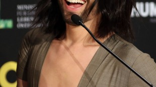Austrian singer Conchita Wurst speaks during a press conference at the Eurovision Song Contest in Austria's capital Vienna, Thursday, May 21, 2015. (AP Photo/Ronald Zak)