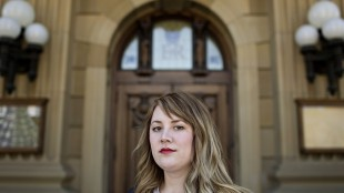NDP MLA for Calgary-Bow Deborah Drever pictured in Edmonton Alta, on Thursday May 21, 2015. Drever says pretending to be assaulted with a bottle for a garage band cover photo is an inexplicable error of youth, but one she is determined to turn the page on. THE CANADIAN PRESS/Jason Franson