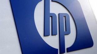 FILE - This Feb. 21, 2012 file photo shows a Hewlett Packard logo in Frisco, Texas. On May 21, 2015, Hewlett-Packard announced it is selling a 51 percent stake in its China sever, storage and technology storage unit for about $2.3 billion as it restructures its business in that country. (AP Photo/LM Otero, File)