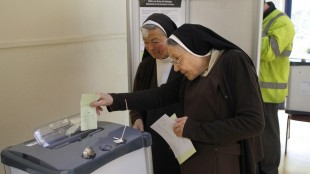 Carmelite sisters cast their vote at a polling station in Malahide, County Dublin, Ireland, Friday, May 22, 2015. Ireland began voting Friday in a referendum on Gay marriage which will require an amendment to the Irish constitution. (AP Photo/Peter Morrison)