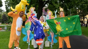 Fans of Australia pose for photos in the song contest park in front of the City Hall prior to the final of the Eurovision Song Competition in Austria's capital Vienna, Saturday, May 23, 2015. (AP Photo/Kerstin Joensson)