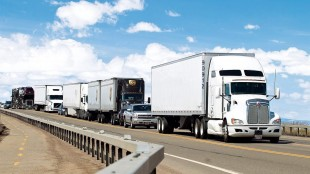 Traffic makes its way to Wyoming Highway 30 on Tuesday, April 21, 2015, in Laramie, Wyo. Trucks hauling cargo from Canada through the United States to Mexico and back navigate border crossings without the need for passports, visas or even a driver to steer them.It's an idea that's not too far-fetched, says a group that met in North Dakota last week. THE CANADIAN PRESS/ Jeremy Martin/Laramie Daily Boomerang via AP