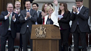 Rachel Notley is applauded after being sworn in as Alberta's 17th premier in Edmonton, Alta., on Sunday, May 24, 2015. THE CANADIAN PRESS/Jason Franson