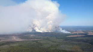 The Little Bobtail Lake wildfire, southwest of Prince George, B.C., is shown on Wednesday, May 20, 2015. A wildfire raging mostly out of control over the past two weeks in British Columbia's Central Interior has been largely contained. Fire teams have managed to bring the Little Bobtail Lake fire about 80 per cent under control, though about 80 people remain forced from their homes. THE CANADIAN PRESS/HO - British Columbia Wildfire Management Branch