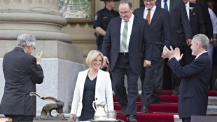Rachel Notley is applauded as she makes her way in to be sworn in as Alberta's 17th premier in Edmonton, Alta., on Sunday, May 24, 2015. THE CANADIAN PRESS/Jason Franson