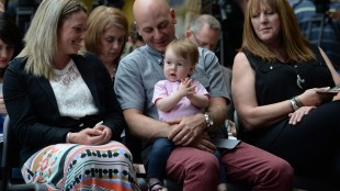 Victoria, who turns one tomorrow, is seen with her mother Melissa McMahon, left, and father Simon Boisclair, of Trois-Rivieres, Que., in Ottawa on Monday, May 25, 2015, during an announcement the launch of a Facebook AMBER Alert System in Canada. Victoria was taken from a hospital in Quebec last year and was found thanks in part to Facebook. Celine Ethier, the mother of Melanie Ethier, who went missing in 1996 sits at right. THE CANADIAN PRESS/Sean Kilpatrick
