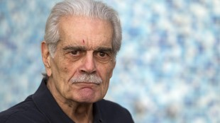 """Actor Omar Sharif poses during a photocall for the Medfilm, Mediterranian Film Festival, lifetime achievement award, in Rome, Thursday, Nov. 24, 2011. Legendary """"Lawrence of Arabia"""" actor Omar Sharif is battling Alzheimer's disease, his agent Steve Kenis confirmed to The Associated Press on Monday. THE CANADIAN PRESS/AP Photo/Andrew Medichini"""