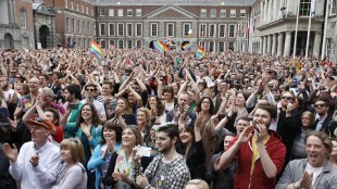 """Yes supporters react at Dublin castle, Ireland, Saturday, May 23, 2015. Ireland has voted resoundingly to legalize gay marriage in the world's first national vote on the issue, leaders on both sides of the Irish referendum declared Saturday even as official ballot counting continued. Senior figures from the """"no"""" campaign, who sought to prevent Ireland's constitution from being amended to permit same-sex marriages, say the only question is how large the """"yes"""" side's margin of victory will be from Friday's vote. (AP Photo/Peter Morrison)"""