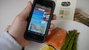 """This April 2015 photo provided by Ecotrust Canada via This Fish shows the """"Boat To Plate"""" smartphone app being created by a group of Maine fishermen and scientists that will allow consumers to source seafood all the way back to the fishermen who caught it. The app is in the development phase, but has already earned a nod from the feds in the form of a grant. (Eric Enno Tamm/Ecotrust Canada via AP)"""
