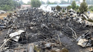 This photo released by China's Xinhua News Agency shows a fire-gutted rest home in Pingdingshan, central China's Henan Province Tuesday, May 26, 2015. A fire swept through the rest home in central China, killing more than 35 people and injuring several, Chinese authorities said Tuesday. The fire broke out Monday night in an apartment building being used as a privately run rest home in the city of Pingdingshan in Henan province, according to a statement from the province's work safety administration. (Zhao Peng/Xinhua via AP) NO SALES