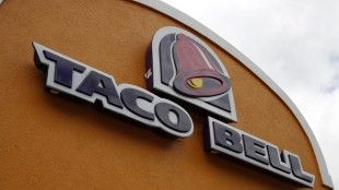 FILE - This Friday, May 23, 2014, file photo shows a sign at a Taco Bell in Mount Lebanon, Pa. Taco Bell and Pizza Hut say they're getting rid of artificial colors and flavors, making them the latest big food companies scrambling to distance themselves from ingredients people might find unappetizing. (AP Photo/Gene J. Puskar, File)