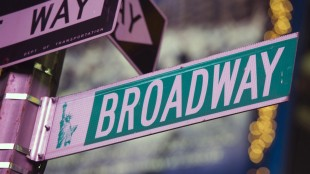 FILE - In this Jan. 19, 2012 file photo, a Broadway street sign is seen in Times Square in New York. Broadway's revenue and attendance figures both hit record highs this season, fed largely by premium prices and a steady stream of more shows. The Broadway League said Tuesday, May 26, 2015, that box offices reported a record total gross of $1.36 billion - up from $1.27 billion from the previous season. (AP Photo/Charles Sykes, File)