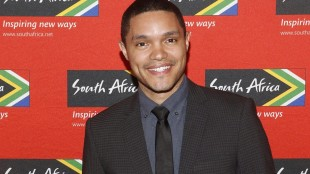 """FILE - In this April 13, 2015 file photo, Trevor Noah, South African comedian and new host of """"The Daily Show"""" on Comedy Central, poses at South African Tourism's sixth annual Ubuntu Awards, at the American Museum of Natural History in New York. Comedy Central says Sept. 28, 2015 will be opening night for Noah, when the 31-year-old will be stepping into the job held by Jon Stewart since 1999. (Jason DeCrow/South African Tourism via AP)"""