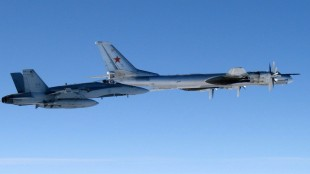 This undated file photo provided by the U.S. Air Force shows a Canadian Air Force F-18 Hornet jet escorting a Russian TU-95 Bear heavy bomber out of Canadian airspace, according to U.S. military. U.S. and Canadian jets are to practise intercepting foreign aircraft high in the Arctic this week as Russian flights bordering on North American air space increase. THE CANADIAN PRESS/HO, U.S. Air Force photo/Master Sgt. Cecilio M. Ricardo J