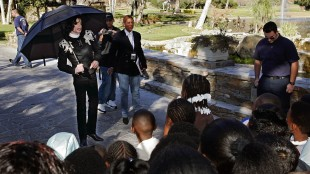 FILE - In this Dec. 17, 2004 file photo, pop star Michael Jackson greets several hundred children that were invited guests at his Neverland Ranch home in Santa Ynez, Calif. Jackson's Neverland is going up for sale. The Santa Ynez Valley property that once served as the late pop star's home and personal fantasyland is being listed for sale at $100 million, according to the Wall Street Journal on Thursday, May 28, 2015. (AP Photo/Mark J. Terrill, File)