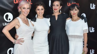 """FILE - In this Wed., May 20, 2015 file photo, Marti Noxon, from left, Shiri Appleby, Sarah Gertrude Shapiro and Constance Zimmer, arrive at Lifetime's scripted series premiere of """"UnREAL"""" at SIXTY Beverly Hills, in Beverly Hills, Calif. Premiering Monday, June 1, 2015, at 10 p.m. EDT on Lifetime, """"UnREAL"""" arrives at what might be a perfect moment. """"UnREAL"""" dwells in the off-camera netherworld of a dating competition show called """"Everlasting,"""" where a handsome stud must choose among a bevy of hot, hopeful women with a fairytale wedding in mind. (Photo by Rob Latour/Invision/AP, File)"""