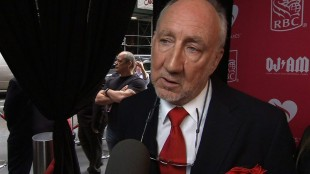 In this image made from APTN video, Pete Townshend arrives at Musicares event in New York, Thursday, May 28, 2015. (AP Photo/APTN)