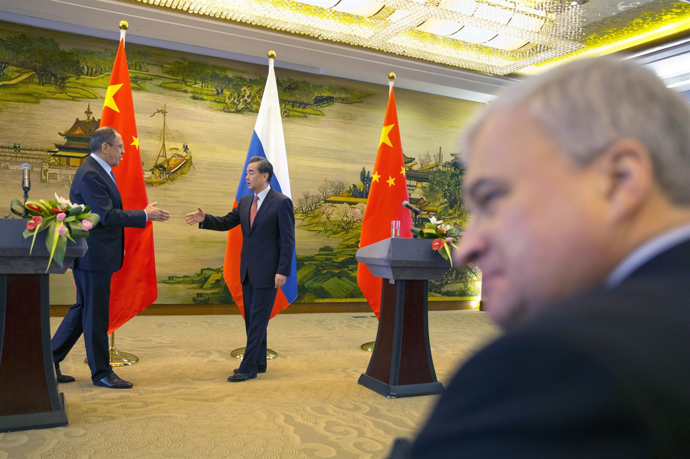 Russia china in agreement on north korea south china sea news 1130 russian foreign minister sergey lavrov left and chinese foreign minister wang yi shakes hands after a joint press conference held at the chinese foreign platinumwayz