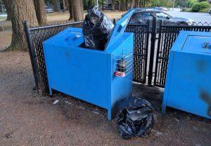 Overflowing garbage bin in Coquitlam park.