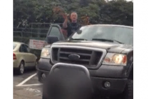 """A man shouts the words """"white power"""" at a man filming a racially offensive argument in Abbotsford."""
