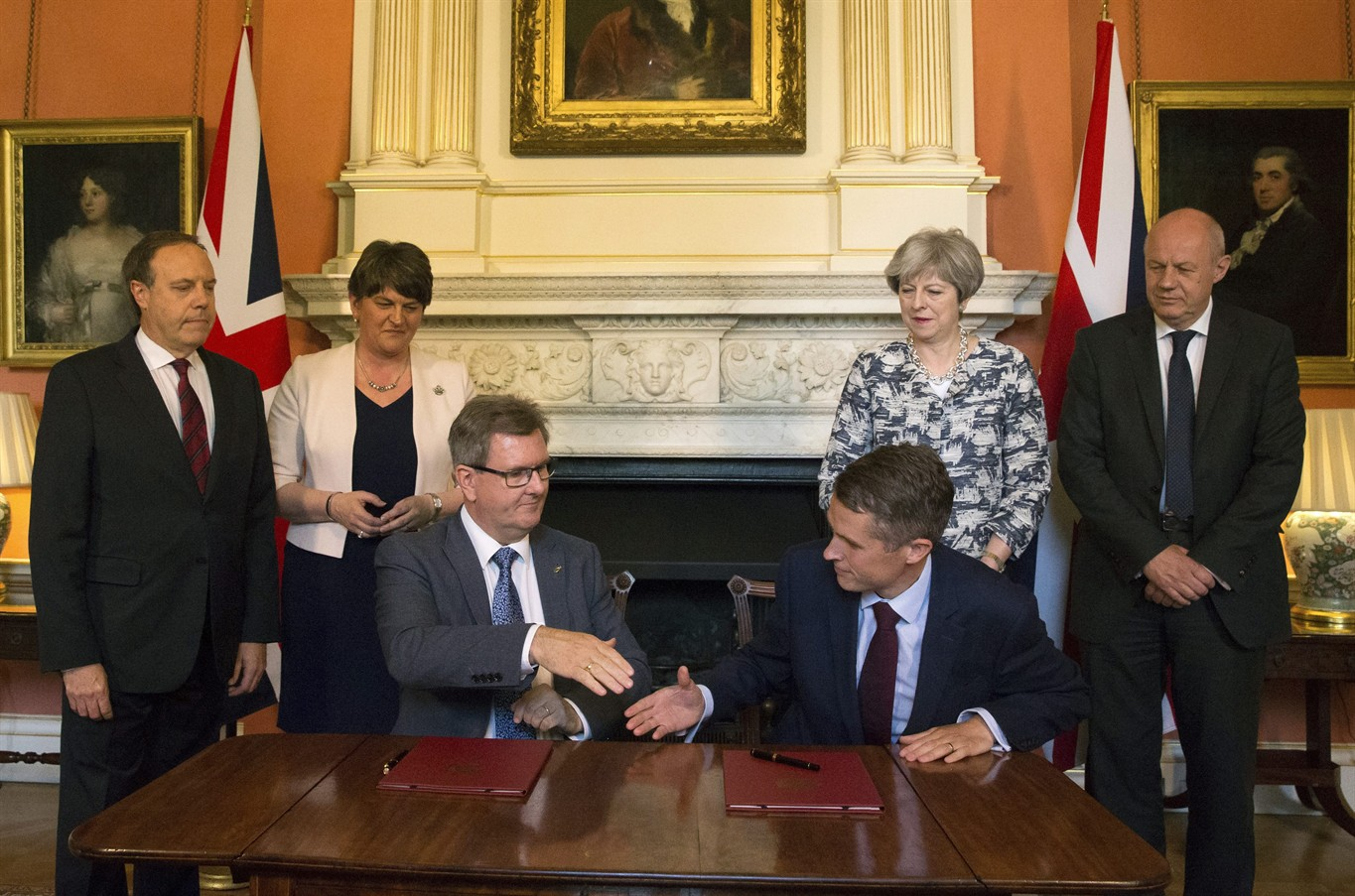 British leader reaches deal she needs to govern