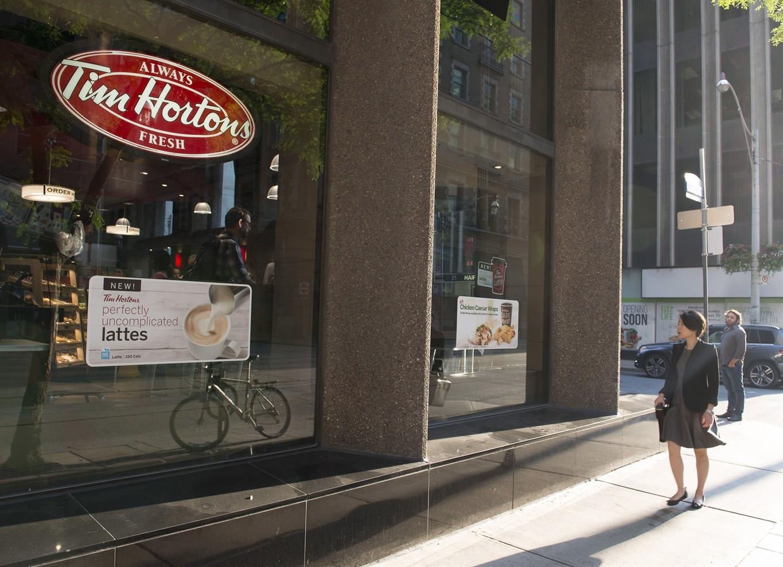 Tim Hortons owner Restaurant Brands posts higher profits, increases prices