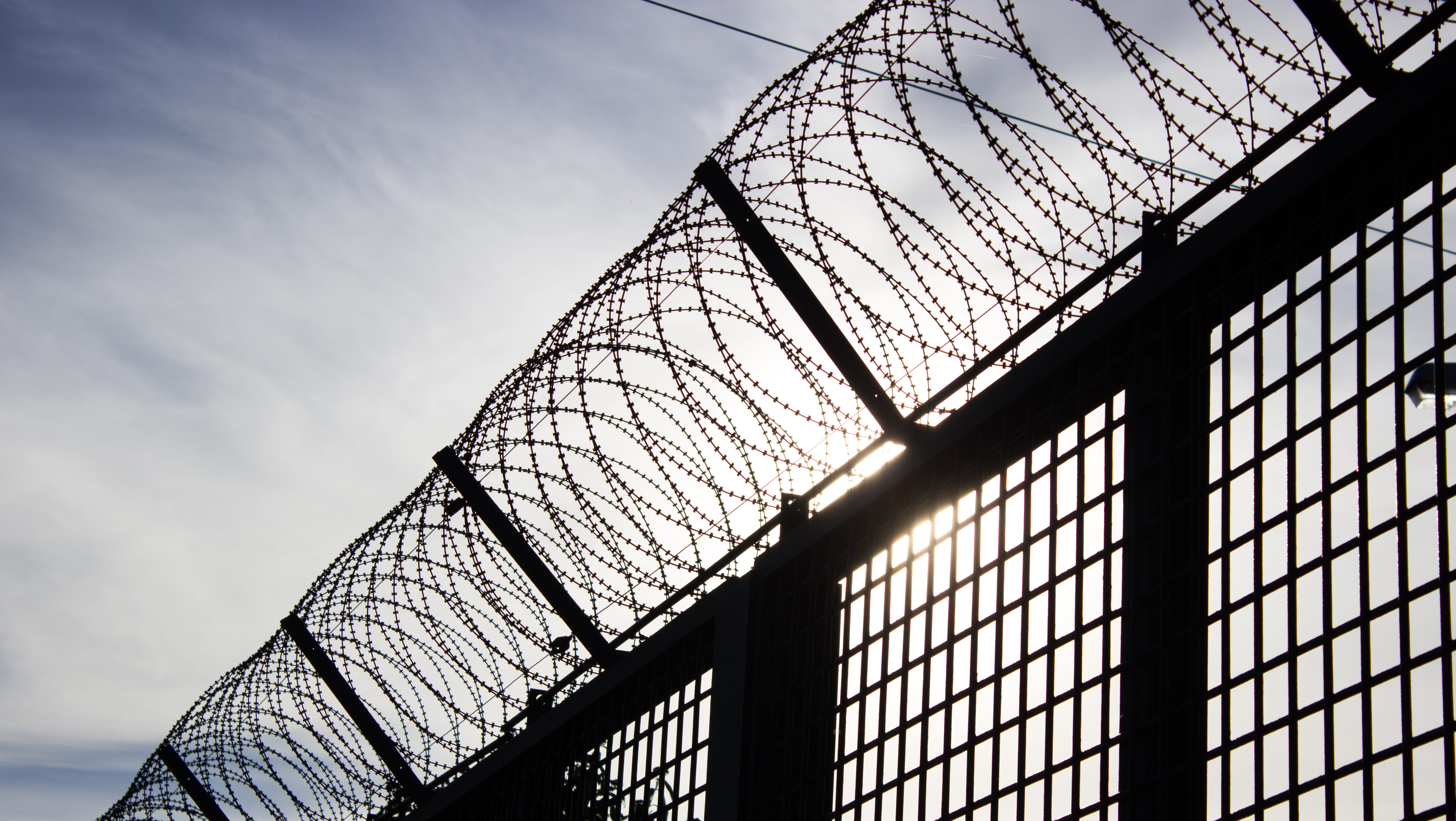 Barbed Wire Fence Prison. Barbed Wire Fence. Prison Fence In Black ...