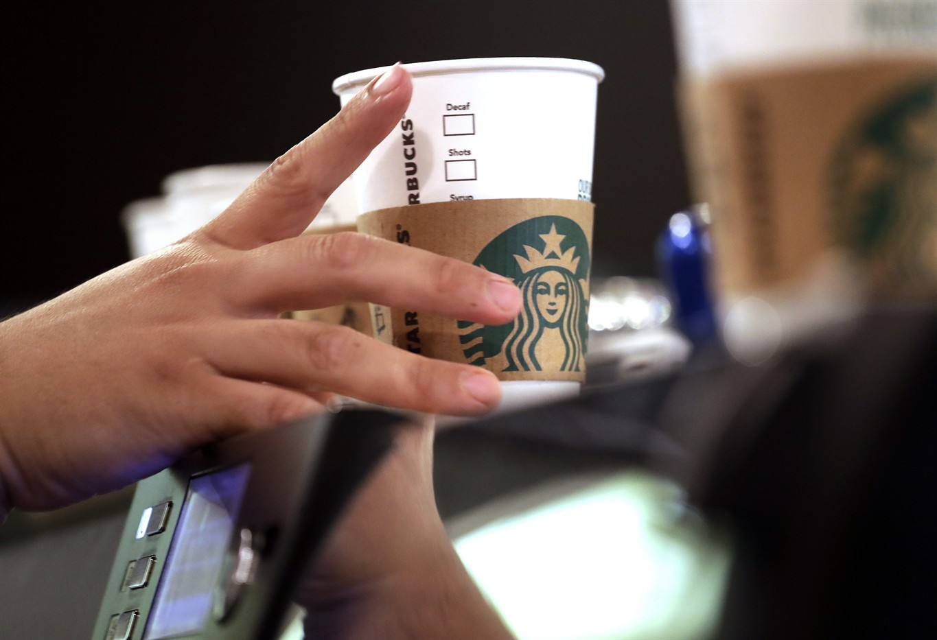Court starbucks others must pay workers for off clock work news 1130 file in this may 29 2018 file photo a barista reaches for an empty cup at a starbucks in the pike place market in seattle thecheapjerseys Gallery