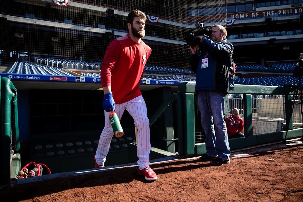 8f90fe203 Philadelphia Phillies right fielder Bryce Harper takes the field for  baseball practice