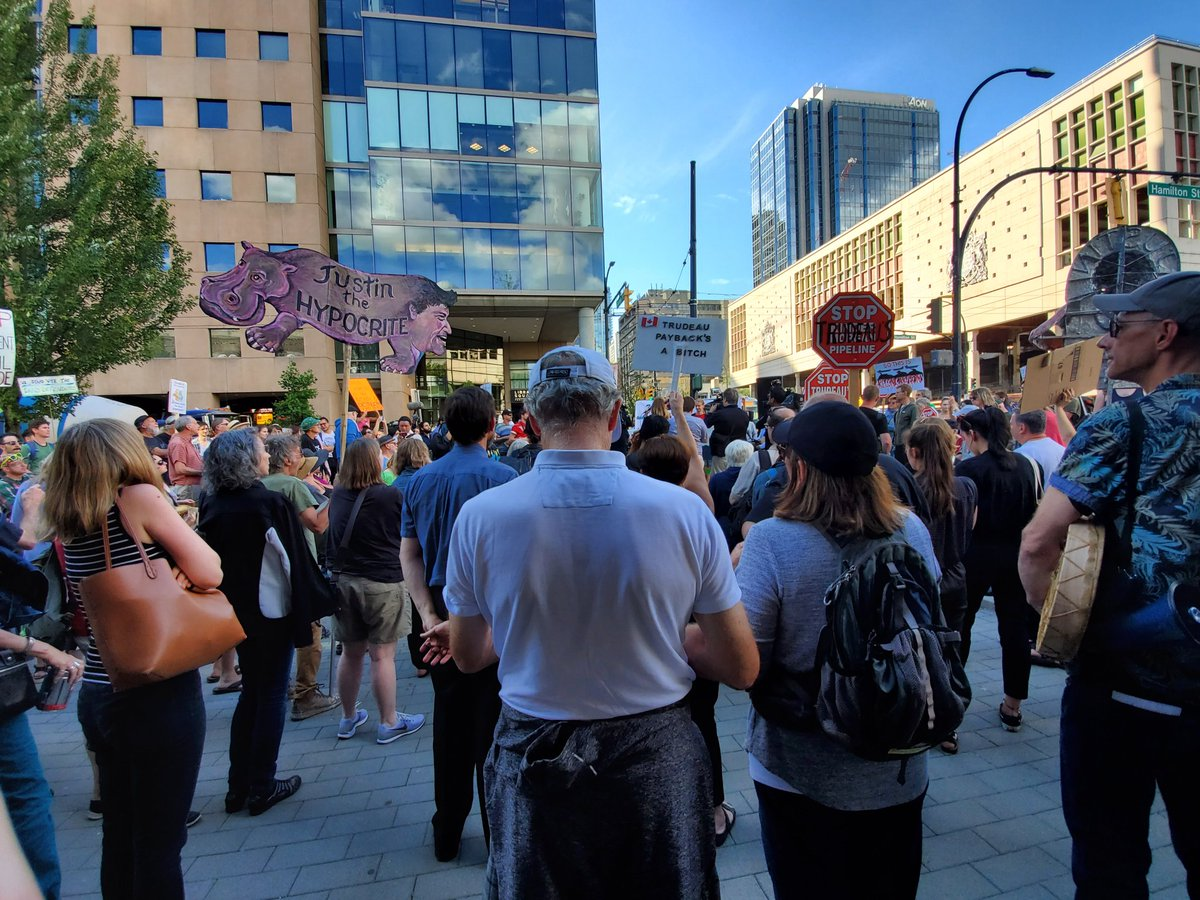 Pipeline protesters march in downtown Vancouver following Trans Mountain expansion approval