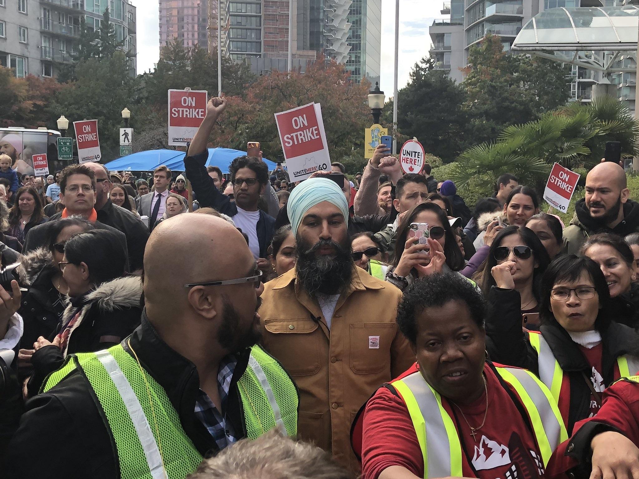 Singh walks picket line with striking hotel workers in Vancouver