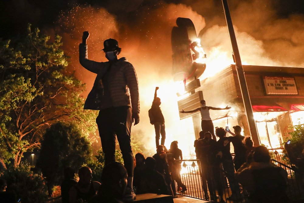 Protesters torch Minneapolis police station in violent night ...